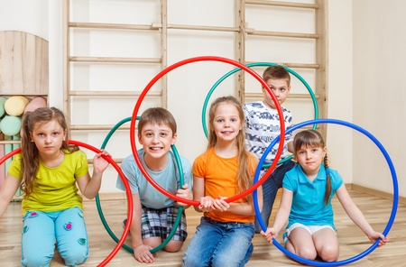 school sports: Group of kids holding hoops