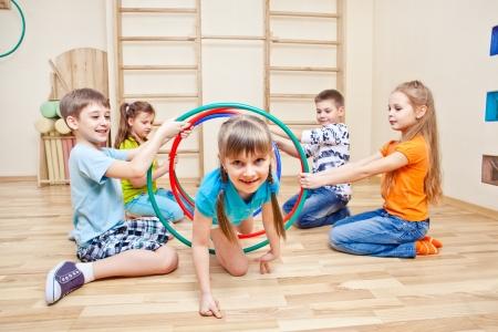 Girl crawling through hoops