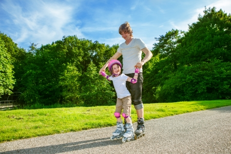 Father and daughter enjoy roller skating photo