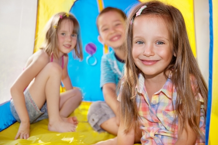 Three kids inside a tent