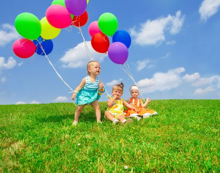 Three lovely toddler kids with balloons photo