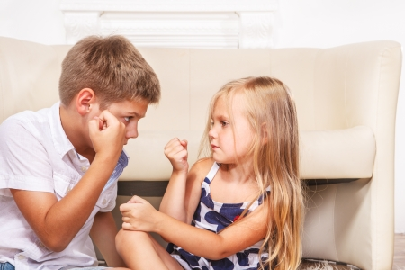 Portriat of angry siblings fighting Stock Photo
