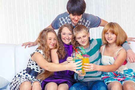 Cheerful teenage friends at a New Year party photo