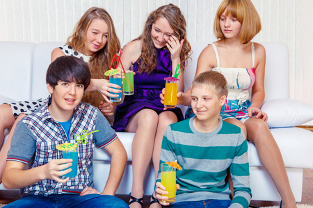 teenagers with beverages photo