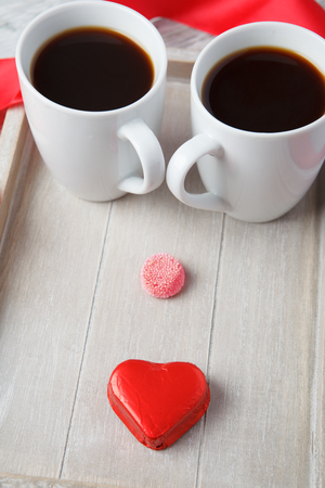 Coffee cups with sweet dessert for Valentine photo