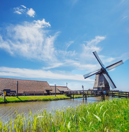 dyke: Old mill, farm houses and dyke, in the Netherlands, North Holland province Stock Photo