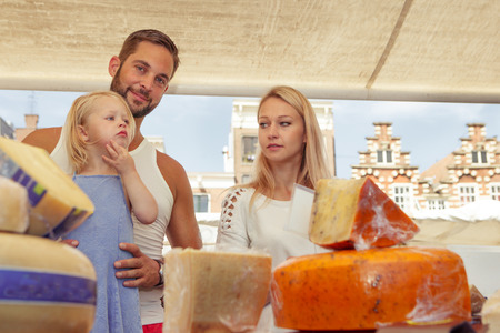 Family buying traditional Dutch  cheese at the local  outdoor market Reklamní fotografie