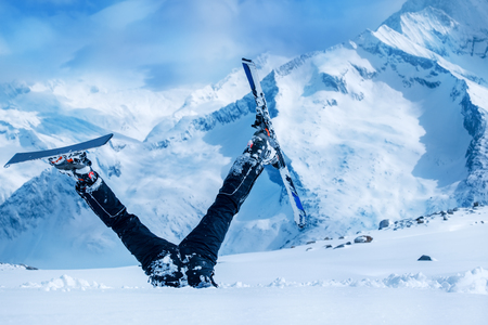 upside down: Newbie skier stuck  in deep snow with his legs upside down