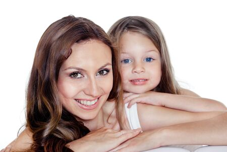 Portrait of young beautiful smiling mother and preschool daughter with blue eys photo