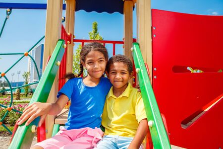 African american brother and sister having fun at the playground on a sunny summer day photo
