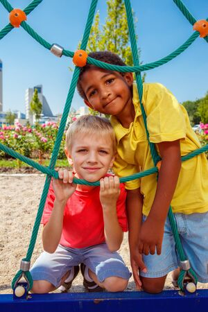 Two boys having fun at the outdoor playground photo