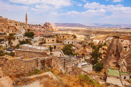 pigeon holes: View on a amazing Uchisar village placed among rocky valleys  in Cappadocia area Stock Photo