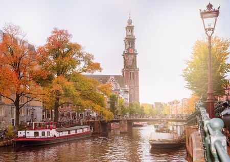 westerkerk: View on one of the famous Amsterdam canals and Westerkerk in autumn