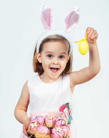 Portrait of an excited Easter kid holding egg decoration Foto de archivo