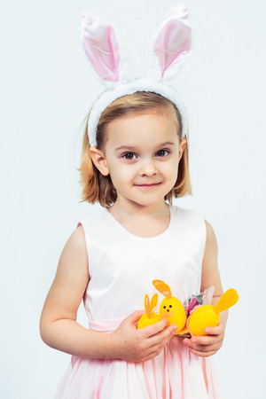 Portrait of a smiling Easter kid holding egg decoration