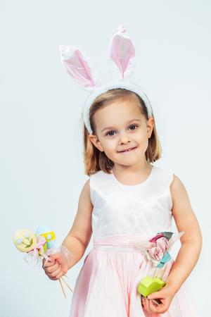 Portrait of a Easter kid holding egg decoration