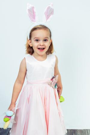 Happy preschool girl holding Easter egg decoration