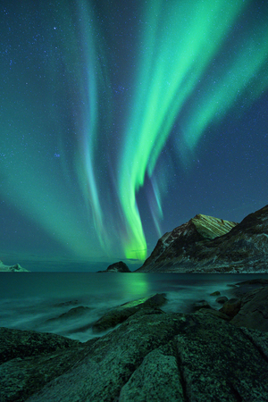 Northern Lights over Haukland beach in winter. Northern landscape. Lofoten Islands, Reine District, Norway Stock Photo