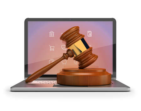 Online auction. Gavel on laptop. 3d image. Isolated white background.