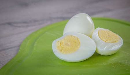 boiled egg isolated on green cutting board