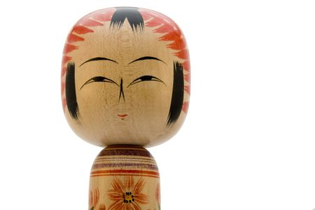 Japanese Kokeshi doll close-up photograph on white background
