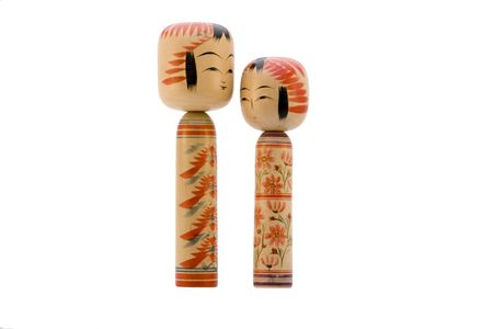 collectibles: Japanese Kokeshi dolls photograph facing each other on white background Stock Photo