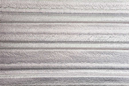 fiberglass: Insulation of attic with fiberglass cold barrier and reflective heat