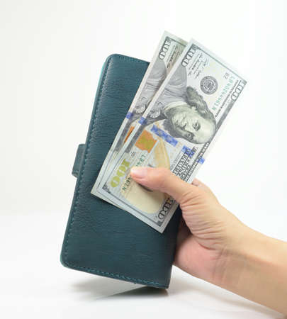commercial activity: Hand with usd money, Save Money Stock Photo
