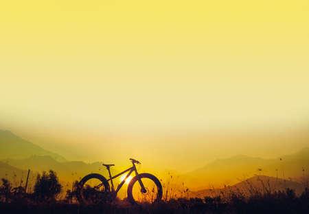snow break: Golden sky sunset and mountain bike silhouette, silhouette fat bike, Silhouette Bicycle  on mountain background