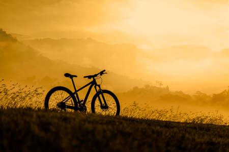 Silhouette Mountain bike on beautiful landscape, Silhouette Bicycle sunset on beautiful landscape mountain nature