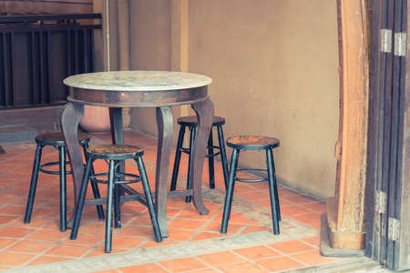 wooden color: Old Wooden tables and chairs add vintage color Stock Photo