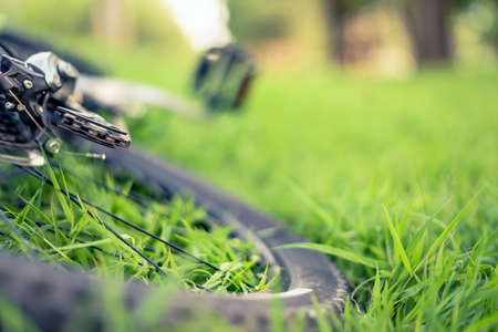 Soft focus of mountain bike on green grass background