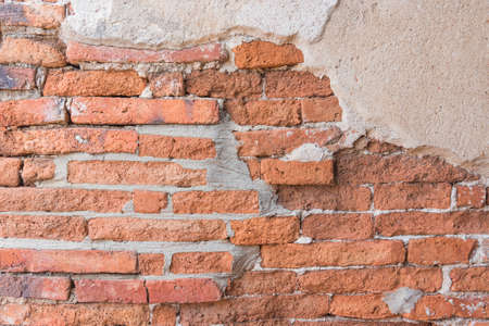 plastered wall: Old Orange Red Brick And Yellow Cracked Plaster Textures