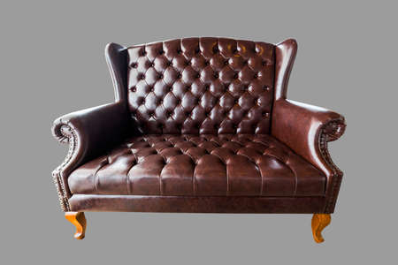Vintage brown leather Sofa isolated on white background include clipping path Standard-Bild