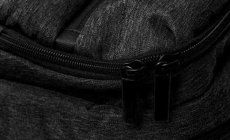 close-up black zip on bag