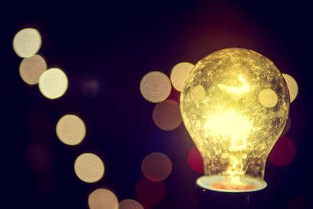Light bulbs on  bokeh background Vintage tone.idea concept.