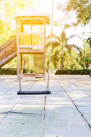 Old wooden Empty swing placed in the garden. Stockfoto
