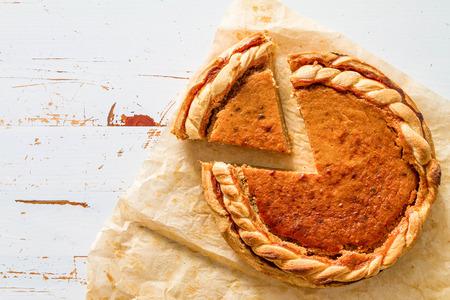pumpkin pie: Pumpkin pie, white wood background, top view