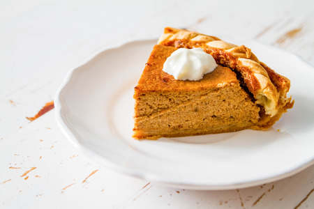 pumpkin pie: Pumpkin pie and decorations, white wood background, closeup Stock Photo