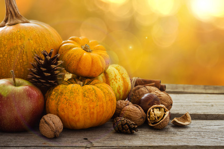 Autumn nature concept. Fall fruit and vegetables on wood. Thanksgiving dinner. Blur background, light effect Stock Photo