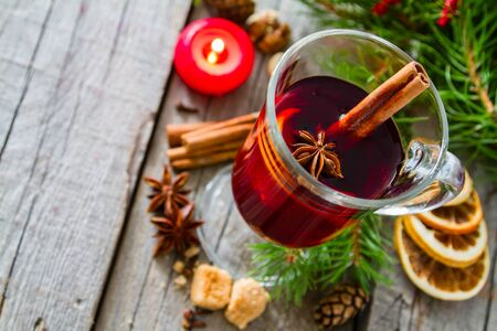 punch spice: Mulled wine and ingredients on rustic wood background