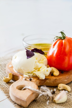 caprese: Caprese salad ingredients, white wood background, closeup Stock Photo