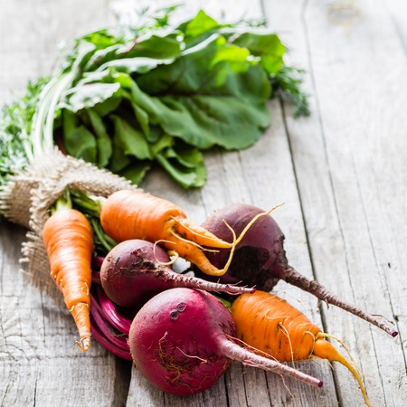fresh vegetable: Raw beet and carrot on rustic wood background, copy space Stock Photo