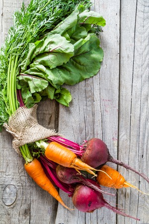 vegetable garden: Raw beet and carrot on rustic wood background, copy space Stock Photo