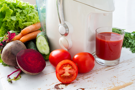 rainbow cocktail: Selection of vegetables and juice, white wood background Stock Photo