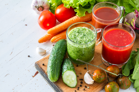 Selection of vegetables and juice, white wood background Stock Photo