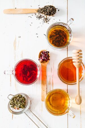 teas: Selection of different teas, top view, white wood background