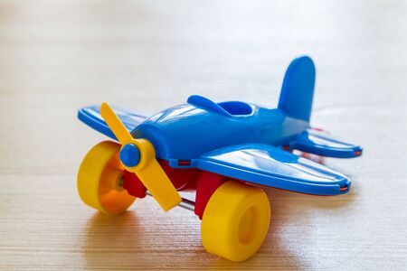didactic: Airplane on wood background with copy space Stock Photo