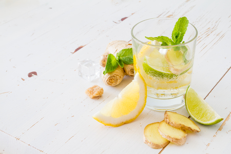 ginger: Ginger lemonade ingredients, white wood background, copy space