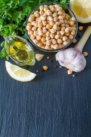 garbanzo bean: Hummus ingredients, dark stone background, copy space